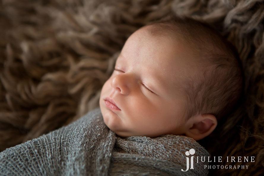 side profile newborn blue wrap