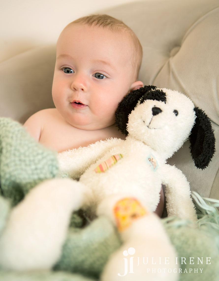 baby boy with his stuffed dog