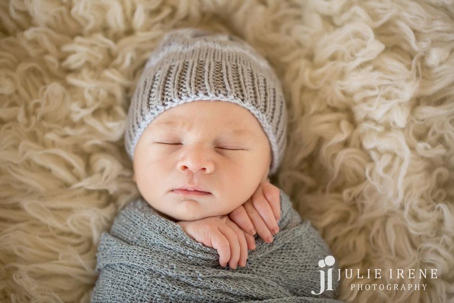 infant boy fingers showing
