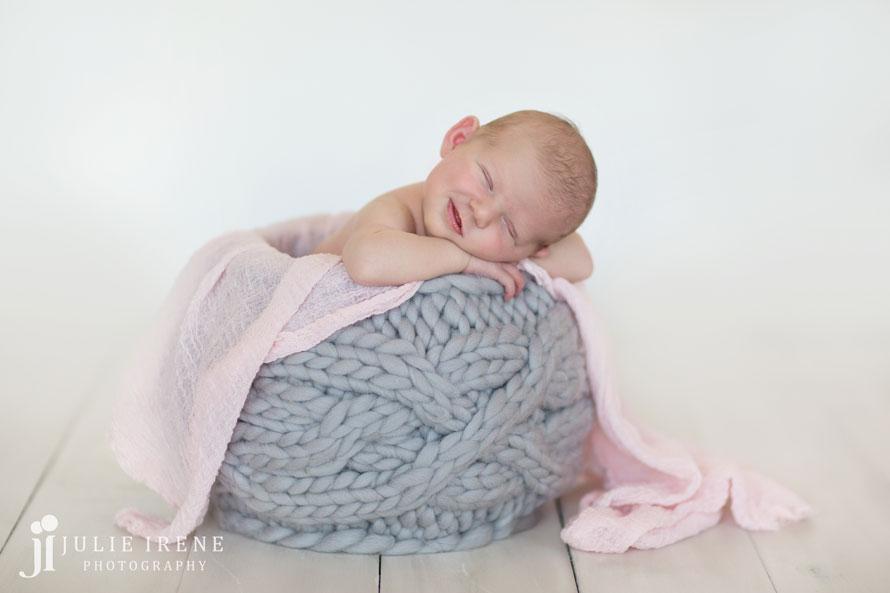 smile gray basket newborn girl pink