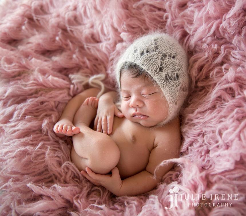 side angle pink flokati amari newborn photo