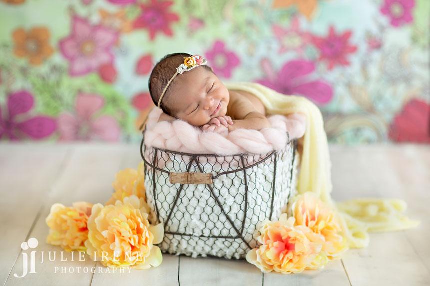 flower background newborn photo posed flowers smiling baby