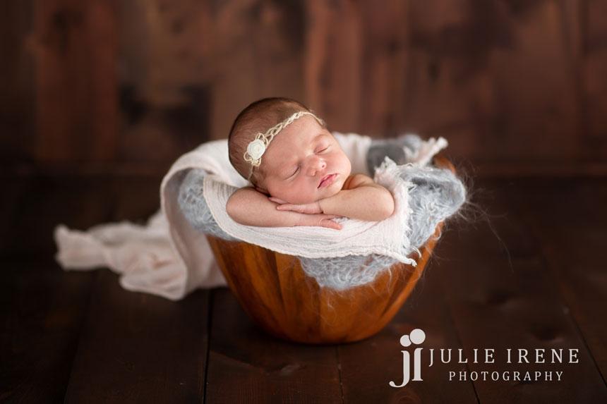 baby bucket girl gray wood background photo